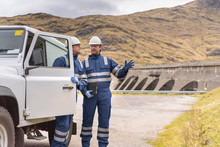 Workers With Utility Vehicle B...