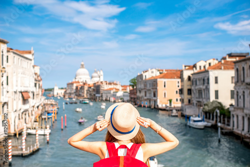 Canvas Print View on Grand canal with woman traveler in hat on Academia bridge in Venice