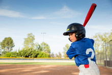 Boy Preparing To Bat At Practise On Baseball Field
