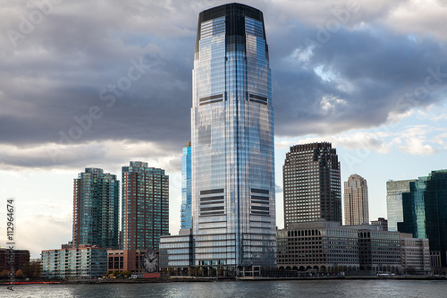 Low Angle Architectural View of Modern Glass Skyscrapers Featuring One World Tra плакат