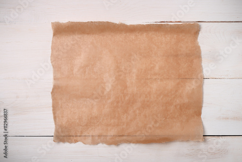 Cooking paper sheet on wooden board Canvas-taulu