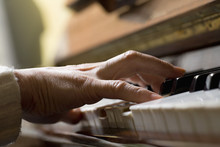 Piano Chord Pressed By Woman's Hand