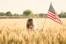 Little Girl Holding American F...