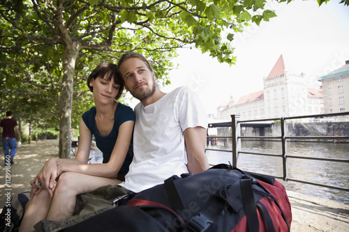 A young couple relaxing by the Spree river, Berlin, Germany