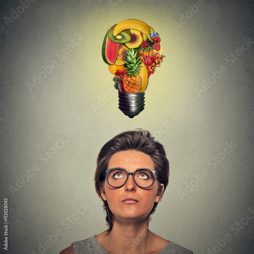 eating healthy idea and diet tips concept woman looking up light