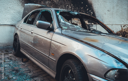 Photo  Totally incinerated burnt out luxury sedan