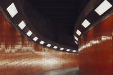 Illuminated Walkway In Tunnel