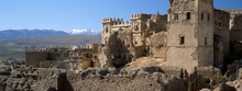 Ruins Of Glaoui Kasbah At Telouet, With Snow Capped High Atlas Mountains In Distance, Telouet, Morocco