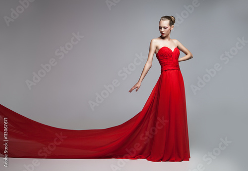 Fotografie, Obraz  Model with flying skirt of red dress