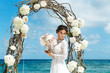 Beautiful brunette fiancee in white wedding dress with big long