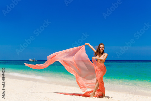 Printed kitchen splashbacks Artist KB Happy beautiful young girl in pink bikini with waving in the win