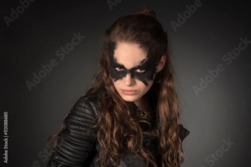 фотография  Subculture, fantasy concept. Portrait of wild, tough girl holdin
