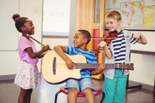 Smiling Kids Playing Guitar, V...