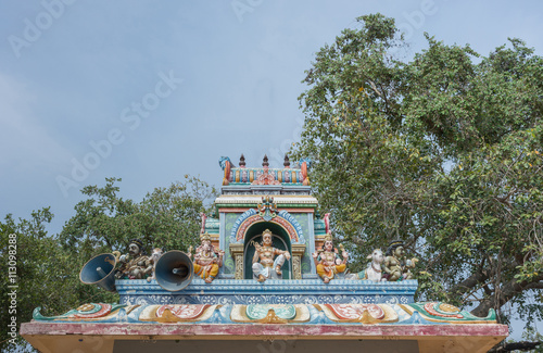 Chettinad, India - October 17, 2013: Kothamangalam Ayyanar horse shrine. On top of small shrine, sits Lord Shiva and his two sons, Ganesha and Murugan. Ayyanar figures on the corners.