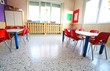 kindergarten with desks and small red chairs