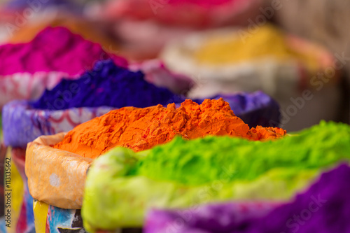 Keuken foto achterwand India Colorful piles of powdered dyes used for Holi festival in India
