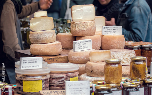 Staande foto Zuivelproducten Sheep Milk Cheese. Organic produce for sale at market.