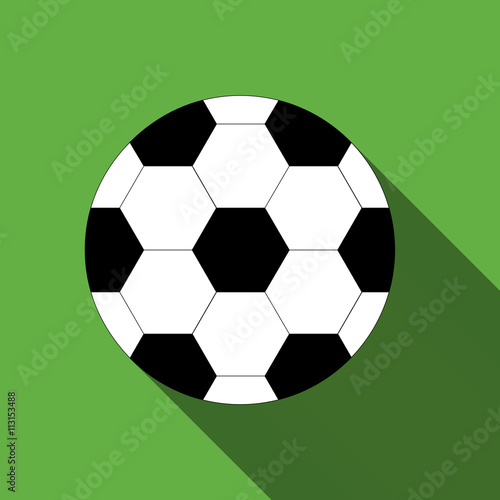 Photo  Soccer ball on green background with long shadow.