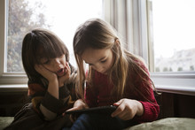 Boy (4-5) And Girl (4-5) Using...