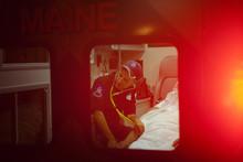 Paramedic Checking Heart Rate ...