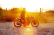 Biker on road at sunset