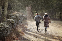 Young Couple Running On Grassy Path