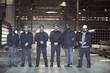 Portrait of steel workers standing