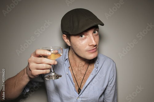 Young man raising glass for toast