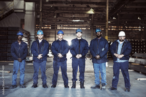 Group of workers standing in row