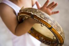 Сhild With Uzbek National Instrument Doira