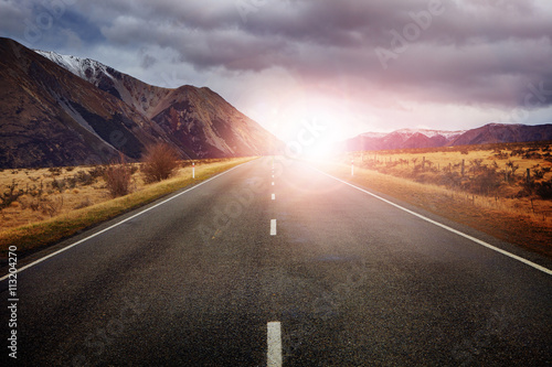 Staande foto Nieuw Zeeland beautiful sun rising sky with asphalt highways road against snow