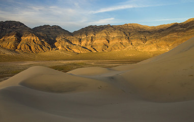 Fototapeta na wymiar Late afternoon light and colour on the rocks on the last chance mountains rising above Eureka Dunes, Death Valley National Park, California, United States