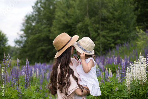Fotografering  Boho style family during summer vacation in wood glade