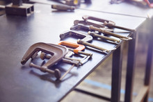 Clamps In Row On Workbench