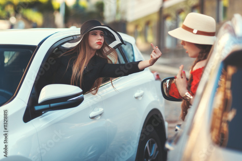 Woman from the car shows indecent gesture. Wallpaper Mural