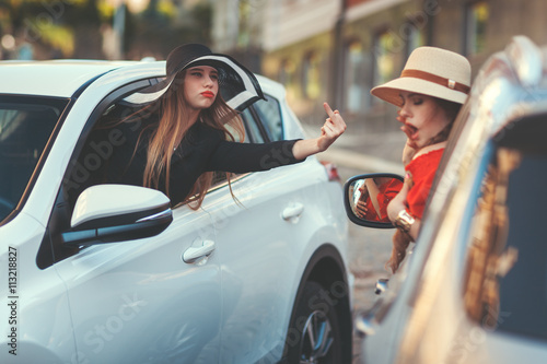 Woman insults another driver. Wallpaper Mural