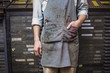 Dirty apron of printing house worker