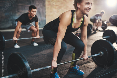 Cadres-photo bureau Fitness Woman performing dead lift barbell exercise