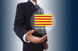 Businessman hand showing Catalonia Flag