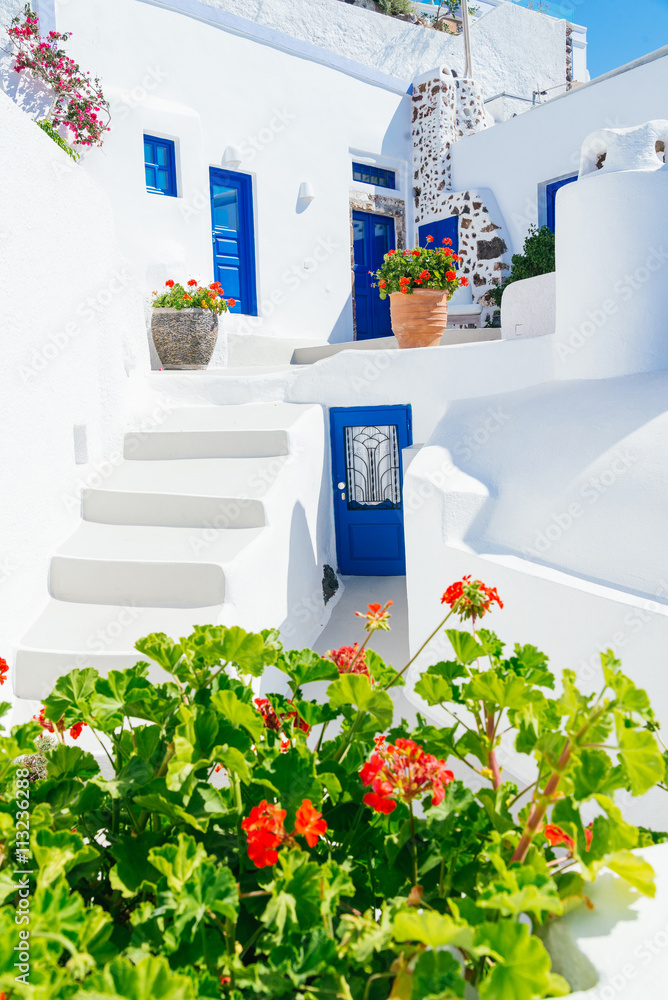 Fototapety, obrazy: Traditional cycladic whitewashed architecture with blue doors and flower pots, Imerovigli, Santorini island, Greece