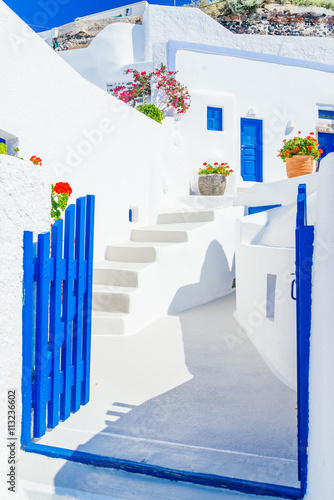 Fototapety, obrazy: Traditional architectural detail of Santorini street with whitewashed streets and blue gates, Greece