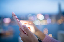 Woman Use Of Mobile Phone At N...