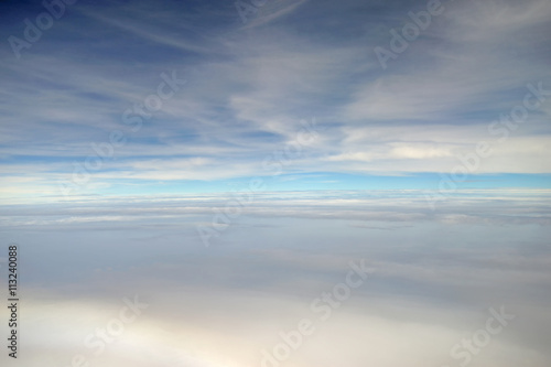 In de dag Donkerblauw clouds view from the window of an airplane