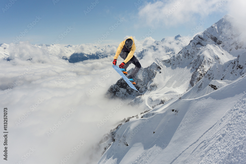 5c75f80d1f2 Photo   Art Print Snowboard rider jumping on mountains. Extreme freeride  sport.