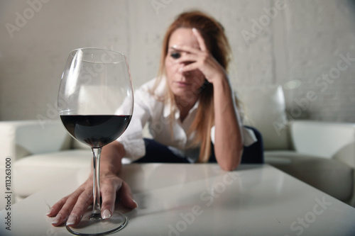 Foto op Plexiglas Bar sad depressed alcoholic drunk woman drinking at home in housewife alcohol abuse and alcoholism