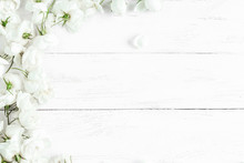 Dog Rose Flowers On White Wooden Background, Frame, Top View, Flat Lay
