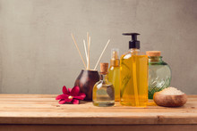 Body Care Products And Aromatic Essence Oil Bottle On Wooden Table
