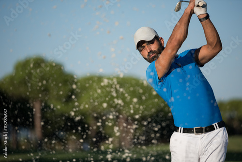Leinwand Poster pro golfer hitting a sand bunker shot