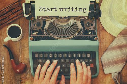 Keuken foto achterwand Retro man typing on vintage typewriter with text: START WRITING
