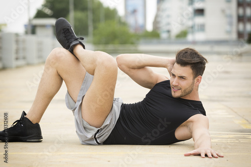 Fotografie, Obraz  Handsome young man exercising outdoors